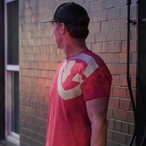 man wearing the red G shirt
